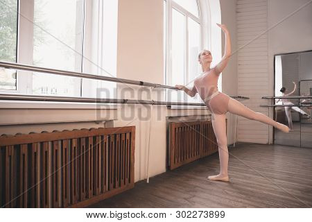 Young Graceful Female Ballet Dancer Dancing At Training Studio. Beauty Of Classic Ballet. Girl Perfo