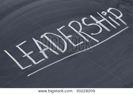 leadership word in white chalk handwriting on blackboard