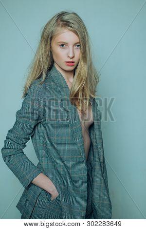 Elegant Woman In Formal Male Suit. Vintage Look. Retro Beautiful Girl With Long Hair. Natural Makeup