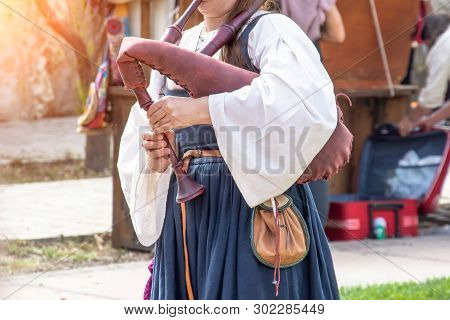 The Girl Plays A Musical Instrument Bagpipe, Close View