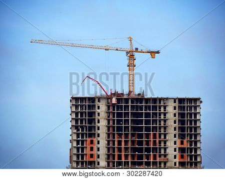 Construction Site Background. Work On The Construction Site. Hoisting Crane And Building Activity.