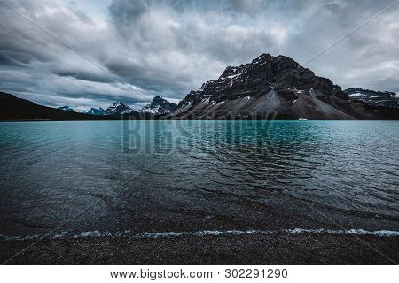 Bow Lake And Crowfoot Mountain, Canada. Crowfoot Mountain Is A Mountain Within Banff National Park I