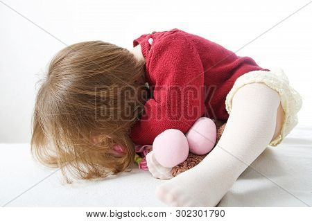 Little Baby Girl Playing Hide And Seek. Cute Baby In Dress