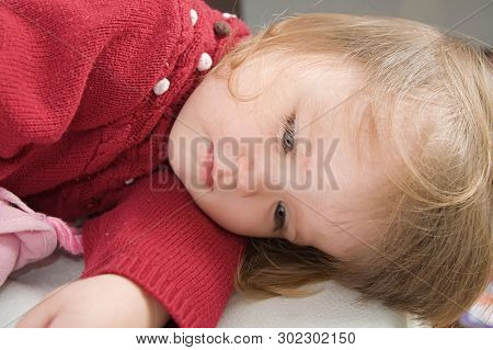 Lying Playing Little Girl Smiling Happy. Cute Caucasian Baby