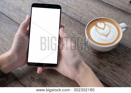 Business Woman Using Smartphone In Caffee Shop. Smart Phone Or Mobile With Blank Screen And Can Be A