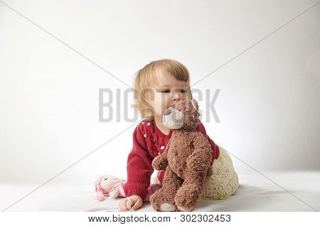Toddler Girl Playing With Teddy Bear Like Animal