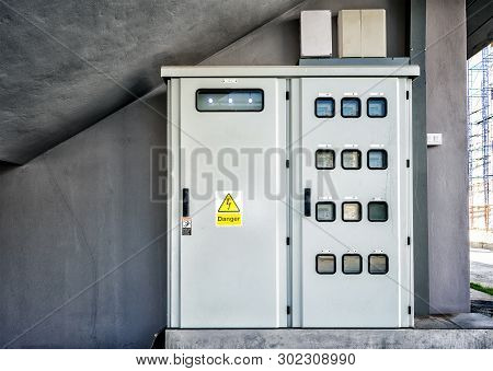 Functioning Electric Meter Panel With A Danger Sign