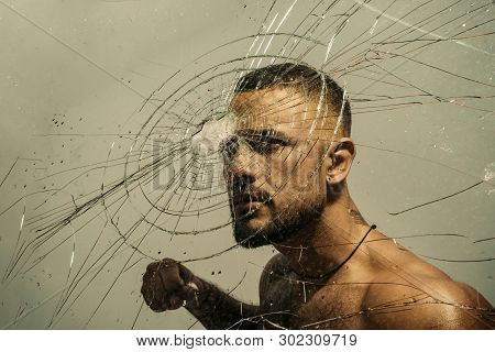 Determination To Succeed. Muscular Man Having Inner Determination And Commitment To Break Glass Wall