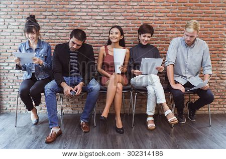 Job Interview. Group Of Multiethnic Casual Businesspeople While Waiting For Job Interview Creative D