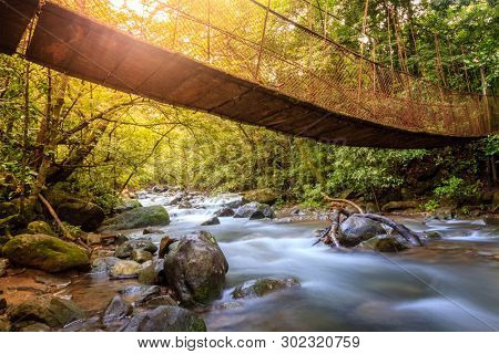 Hanging bridge over a creek in Rincon de la Vieja National Park in Costa Rica