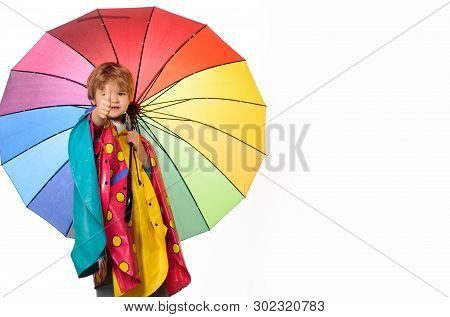 Little Boy With Rainbow-colored Umbrella Isolated On White Background. Raining Kids. Autumn Mood And