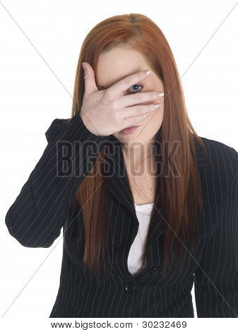 Isolated studio shot of a businesswoman who is peeking even though she just can't look. poster