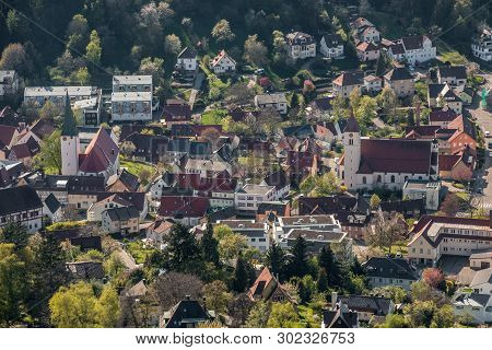 Little Village In The Middle Of The German Countryside With A Church And Half-timber Houses And Gree