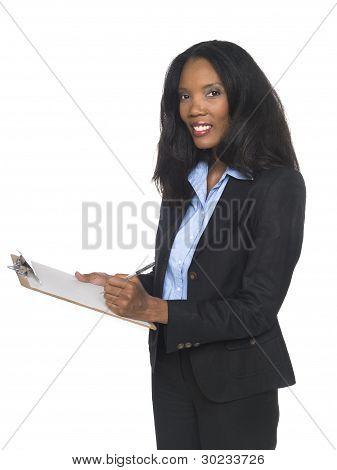 Businesswoman - Writing On Clipboard
