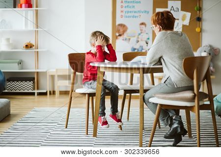 Cute Little Boy With Adhd During Session With Professional Therapist