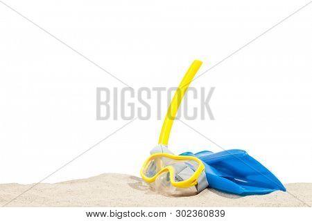 Snorkeling equipment on a sandy beach