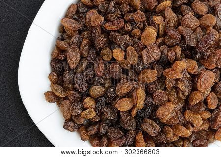 Yellow Seedless Raisins On A Plate, Close-up