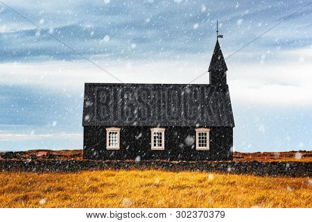Incredible autumn landscape with snowy famous picturesque black church of Budir at Snaefellsnes peninsula region in Iceland