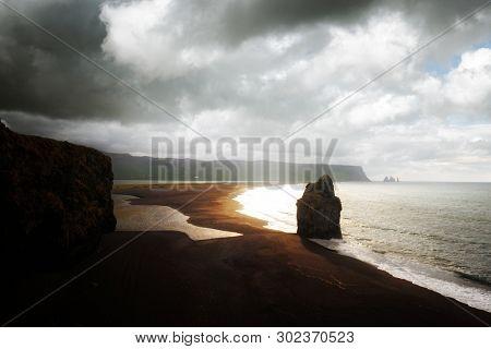 Fantastic landscape with rocks and Atlantic ocean from southern coast of Iceland. Black beach, Reynisdrangar, Vik