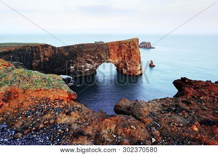 Gorgeous landscape with unique basalt arch on Dyrholaey Nature Reserve, Iceland, Europe