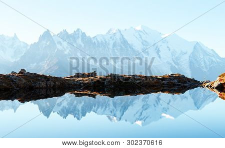 Chesery lake (Lac De Cheserys) and snowy Monte Bianco mountains range on background, Chamonix, France Alps