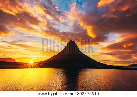 Incredible landscape with Kirkjufell mountain and colorful sunset sky on Snaefellsnes peninsula near, Iceland.