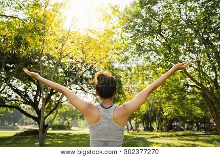 Healthy Young Asian Runner Woman Warm Up The Body Stretching Before Exercise And Yoga Near Lake At P