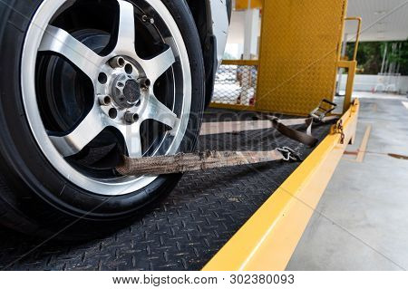 Car Tied With Security Strap On Flatbed Tow Truck
