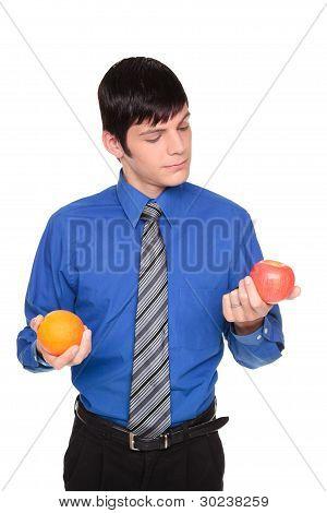 Caucasian Businessman Comparing Apple To Orange