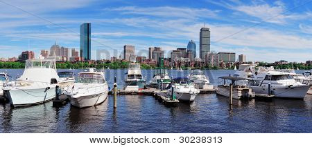 Boston Charles River panorama with urban city skyline skyscrapers and boats with blue sky over Charles River. poster