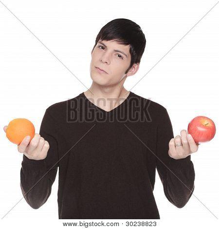 Caucasian Man Comparing Apple To Orange