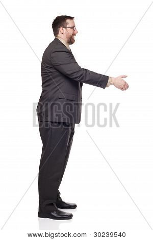 Side View Of Caucasian Businessman Reaching To Shake Hands