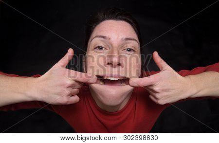 Portrait Of A Woman Making Mockery On Black