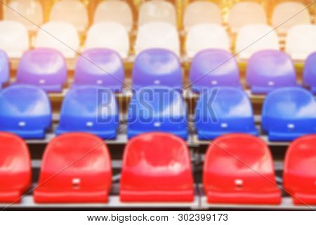 Red, blue and white sports stadium seats. Empty stands, no spectators at the competitions. poster