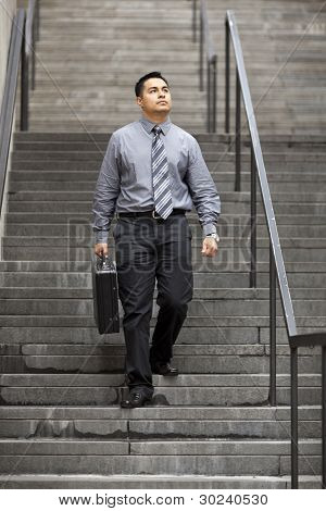 Hispanic Businessman - Walking Down Staircase