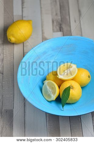 Fresh Yellow Lemons In Blue Plate, Close Up