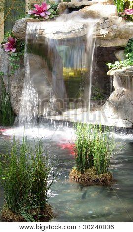 Beautiful cascading waterfall fountain in garden