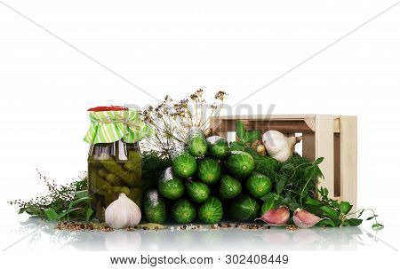 Harvesting Vegetables For The Winter. The Process Of Pickling Cucumbers Isolated On White Background