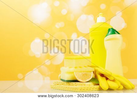 Set Of Tools To Clean The Kitchen. Washing Up Liquid, Sponge On A Bright Yellow Background