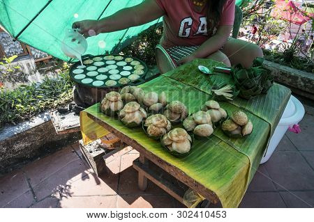 Cooking For Sweet And Savory Grilled Coconut-rice Hotcakes Its For Kanom Krok But Sometimes They Use