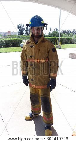 My Job Is Extinguish Fires. On Guard. Firefighter With Uniform And Helmet. Masculinity And Male Job.