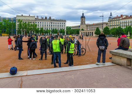 Lyon, France - May 08, 2019: Scene Of Place Bellecour Square, With Yellow Vests Protestors, In Lyon,