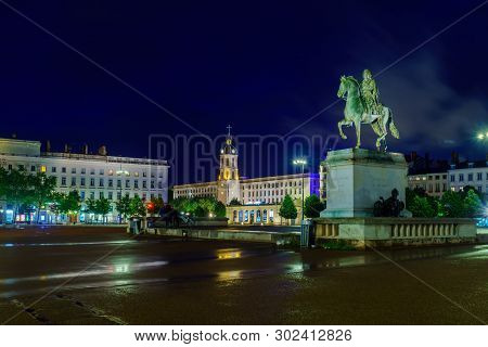 Lyon, France - May 08, 2019: Night View Of The Equestrian Statue Of Louis Xiv, In Place Bellecour Sq