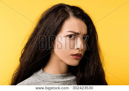 Portrait Of Scared, Watchful Emotional Brunette Girl With Wary, Disturbed, Terrified Facial Expressi