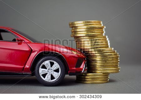 Concept Of  Leasing, Car Loan, New Car Buy. Toy Car Stack Of Coins