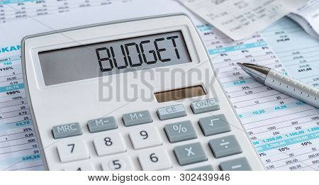 A Calculator With The Word Budget On The Display