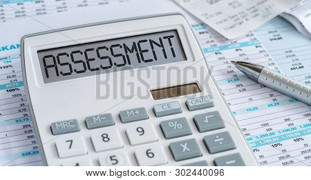 A Calculator With The Word Assessment On The Display
