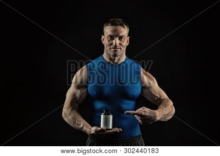 Handsome Bodybuilder Man Or Sexy Muscular Smiling Guy In Blue Vest With Athlete Body, Torso And Ches