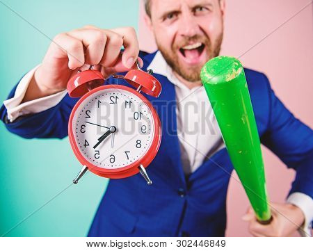 Boss Aggressive Face Hold Alarm Clock And Baseball Bat. Man Suit Hold Clock In Hand And Arguing For