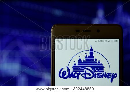 Walt Disney Logo Seen On The Smartphone